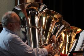 Dad playing 4 tubas
